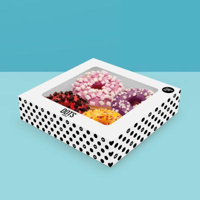 Caja de 4 deliciosos y esponjosos Donuts de sabores distintos (1/2 pers.)